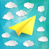 Yellow Paper airplane with clouds on the blue abstract triangula Stock Photo