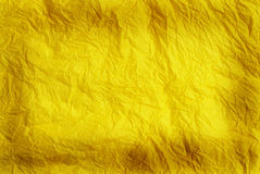 Yellow   Paper Background. Yellow wrinkled tissue paper background with burned edges Royalty Free Stock Images