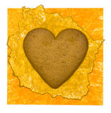 Yellow paper background with cookies heart Royalty Free Stock Images