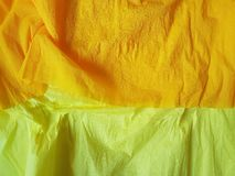 Yellow paper background silk surface empty blank sheets vivid colors. Orange Royalty Free Stock Photo