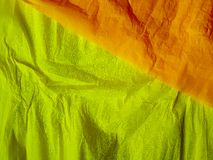Yellow paper background silk surface empty blank sheets vivid colors. Orange Stock Photos