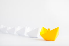 Yellow Paper Boat Leadership Concept on White Background Royalty Free Stock Images