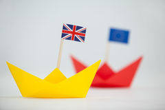 Yellow paper boat with union jack flag. Close-up of yellow paper boat with union jack flag Stock Image