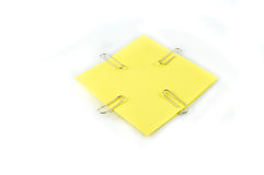 Yellow paper with clips Royalty Free Stock Photos