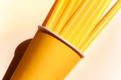 Yellow paper cup and straws stock photo