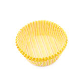 Yellow paper cupcake cup isolated Stock Images