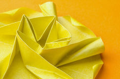 Yellow paper flower on orange background Royalty Free Stock Photos