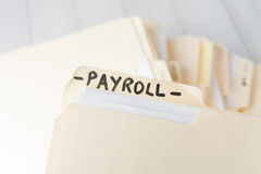 Yellow paper folder labeled PAYROLL Stock Photography