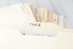 Yellow paper folder labeled TAXES Royalty Free Stock Photography