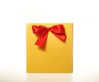 Yellow paper gift bag with a Red Ribbon on white background Stock Photo