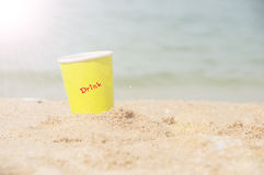 Yellow paper glass beverage Stock Images