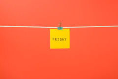 """Yellow paper note on clothesline with text """"Friday"""" Stock Photography"""