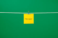Yellow paper note on clothesline with text Friday Stock Photos