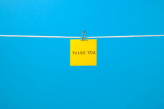 "Yellow paper note on clothesline with text ""Thank You"" Stock Photo"