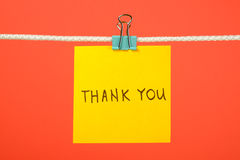 "Yellow paper note on clothesline with text ""Thank You"" Royalty Free Stock Photos"