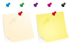 Yellow paper note with colorful pins Royalty Free Stock Image
