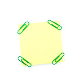Yellow paper note with green clips Stock Photos