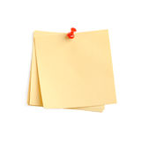 Yellow paper note with red pin. It is attached red pin on a white background Stock Photography
