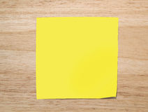 Yellow paper note on Texture of wood Royalty Free Stock Photography
