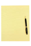 Yellow paper and pen Royalty Free Stock Photos