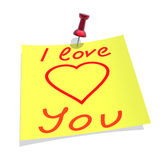 Yellow paper pinned to a white background with inscription. I love you Stock Image