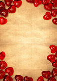 Yellow paper and red hearts Stock Image