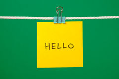"Yellow paper sheet on the string with text ""Hello"" Stock Photo"