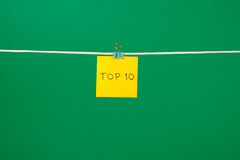 Yellow paper sheet on the string with text Top 10 Stock Images
