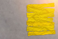 yellow paper tag on grey leather background Royalty Free Stock Photo
