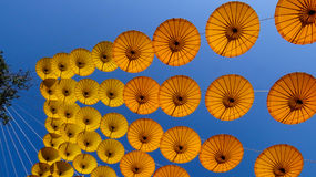 Yellow paper umbrella hanging on rope on sky background. Yellow umbrella hanging on rope,Decoration in garden at flower festival 2017 in Chiangmai city Thailand Stock Photography