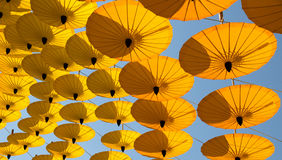 Yellow paper umbrella hanging in the sky Royalty Free Stock Images