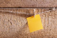 Yellow paper on wooden background Stock Photography