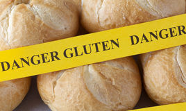 Yellow paper with the words Danger gluten on buns Stock Photos