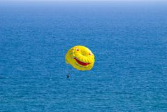 Yellow parachutу and sea Royalty Free Stock Image