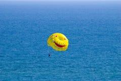 Yellow parachutу and sea Royalty Free Stock Image
