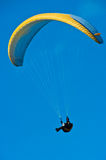 Yellow parachute in blue sky Royalty Free Stock Photography