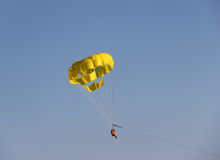 Yellow parachute in the sky. Flying yellow parachute in the sky Stock Photos