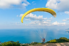 Yellow paraglide. On the top of the hill Stock Photo