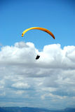 Yellow paraglider in the sky. Paragliding in Macedonia Royalty Free Stock Photo