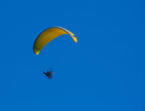 Yellow paragliding on flight Stock Photo
