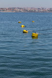 Yellow parking floats in marine on coast Royalty Free Stock Image