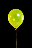 Yellow Party balloon on black Stock Images