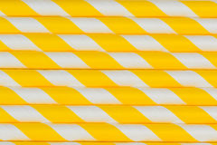 Yellow party straws background. Stacks of yellow striped party straws stacked on top of each other Stock Photo