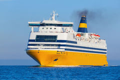 Yellow passenger ship goes on the Sea Stock Photography
