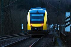 Yellow passenger train in the evening stock photography