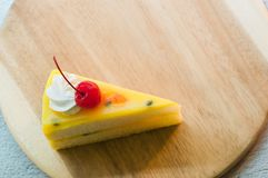 Fresh passion fruit cake dessert on wooden plate stock photography