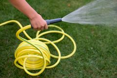 Yellow pastic hose pipe Stock Photos