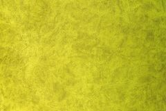 Yellow patterned surface of velvet fabric on top. Texture of artificial cloth royalty free stock photos