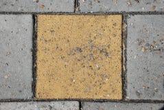 Yellow paving stone Royalty Free Stock Image