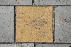 Yellow paving stone Royalty Free Stock Image